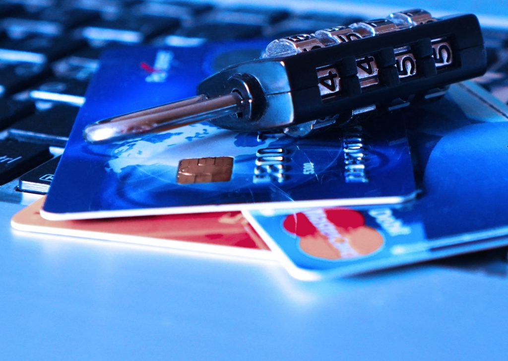 credit card purchase protection, a picture of credit cards and a lock with code on top