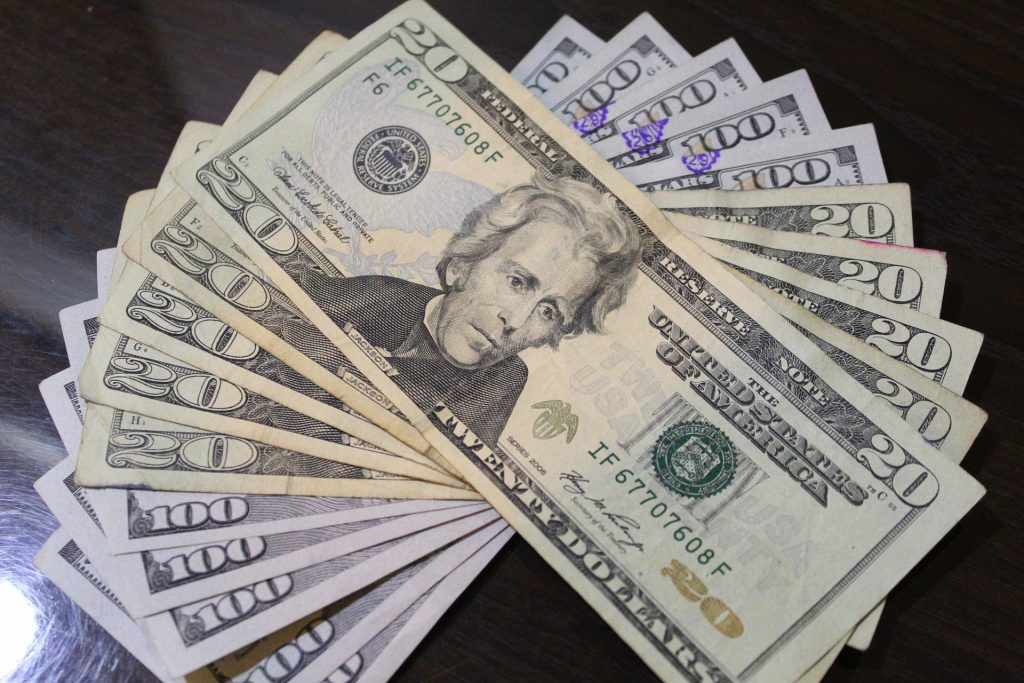 high level debt solutions, a picture of dollar bills