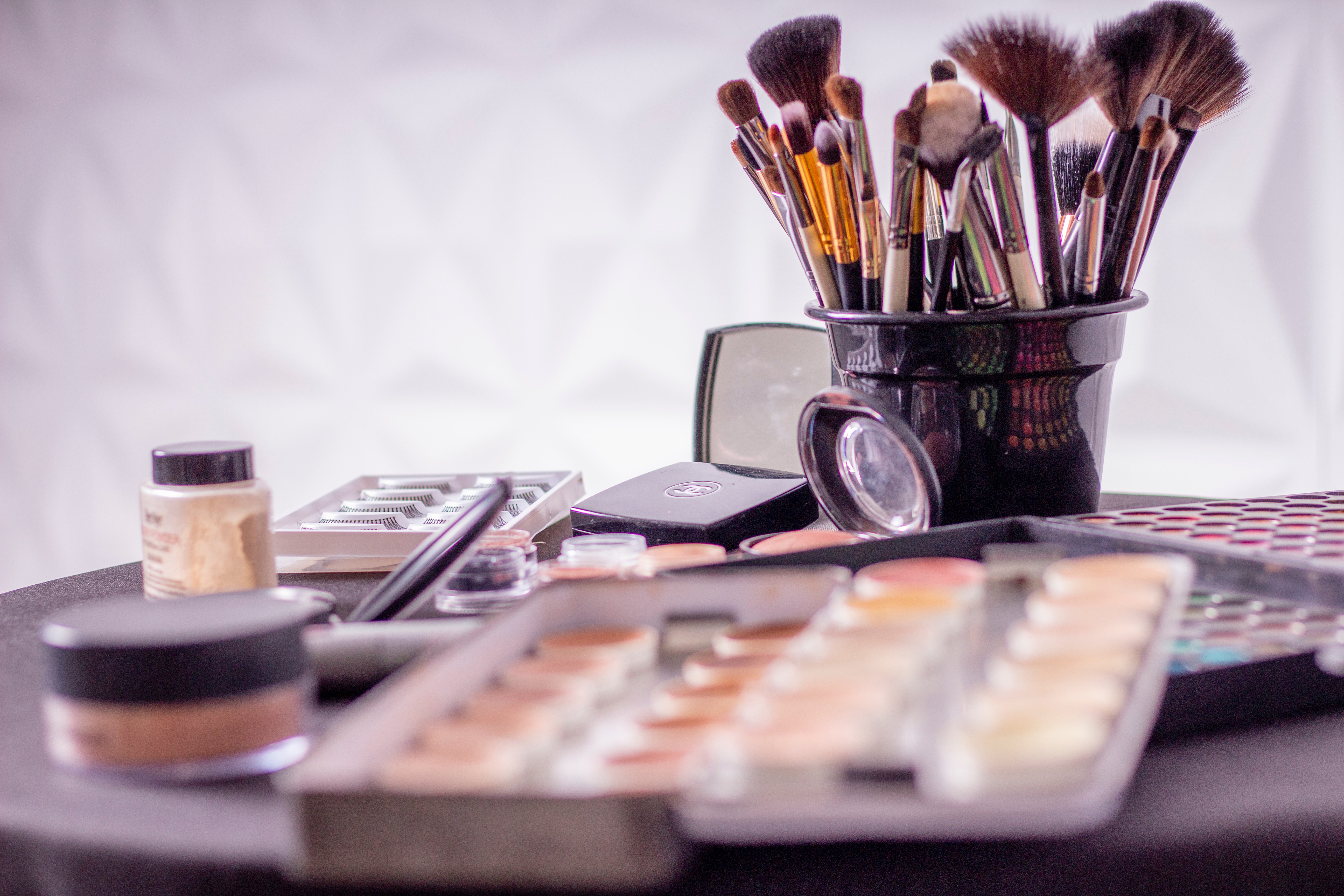 how to tell if makeup is expired or not? A picture of random Makeup and brushes