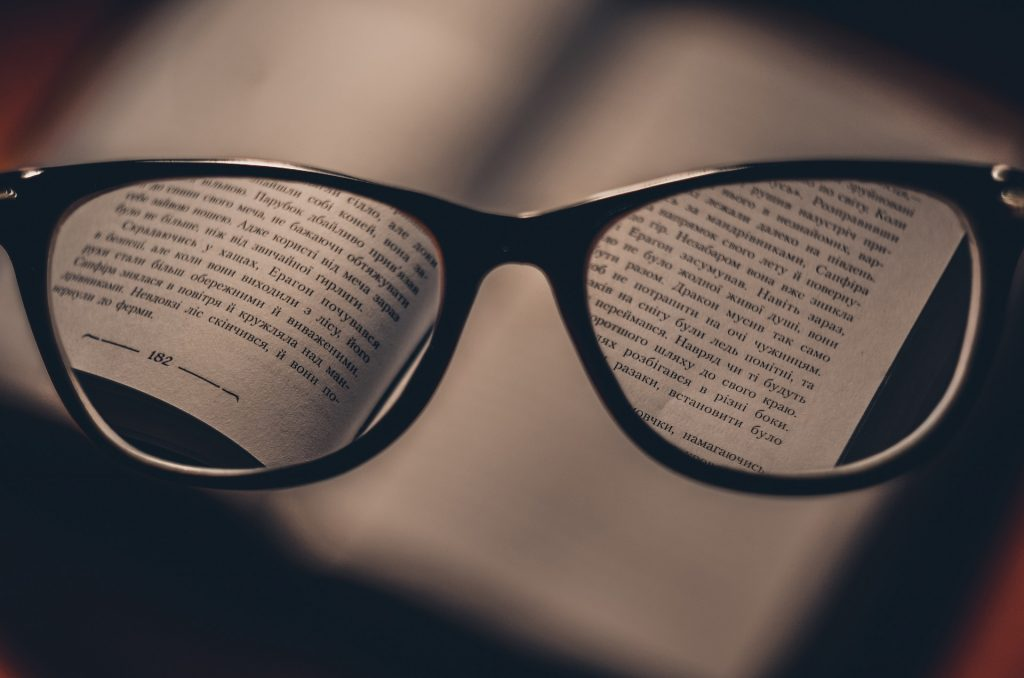 should i get vision insurance, a picture of glasses and a book