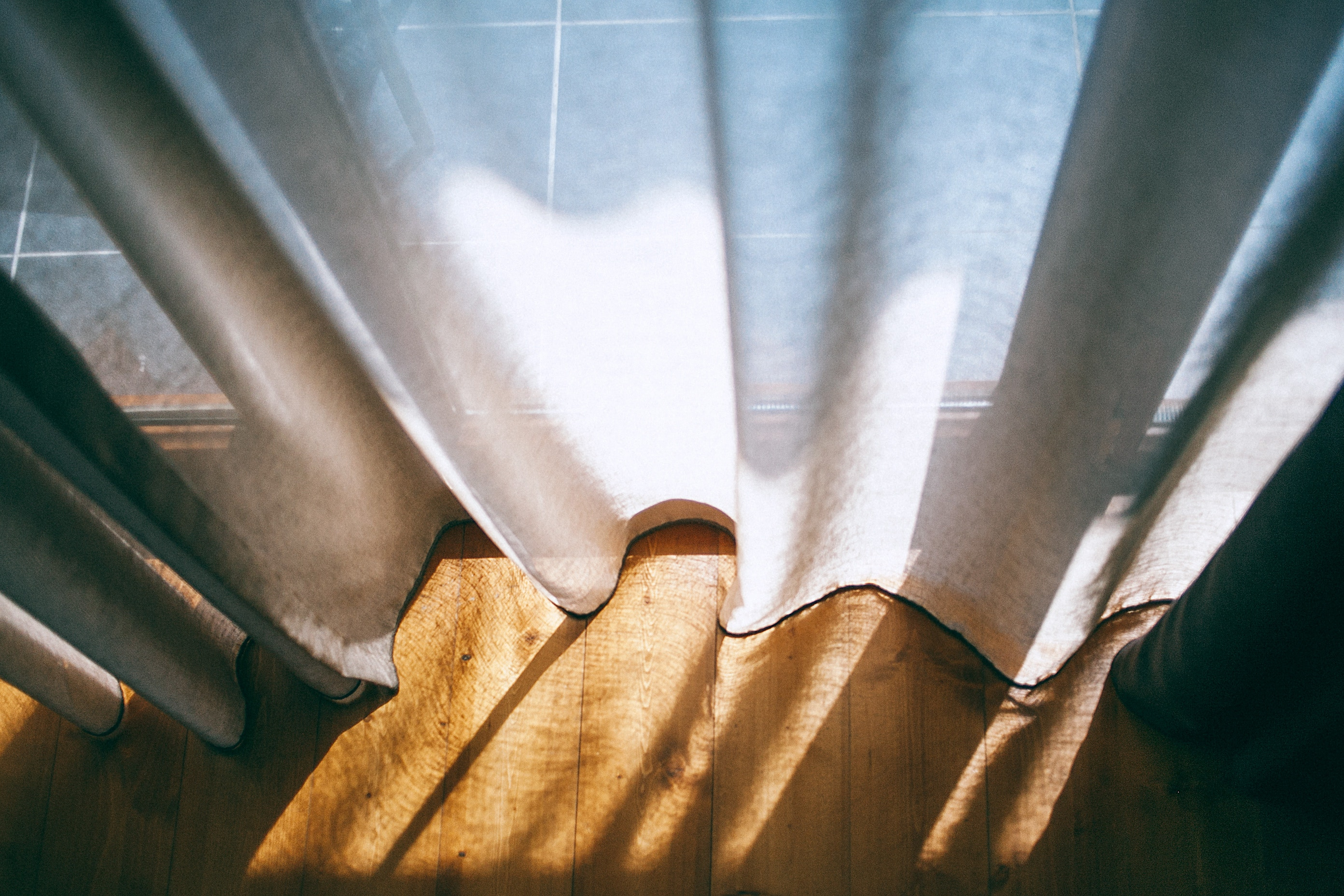 DIY Window Cornice, picture of a curtain with sun shadows