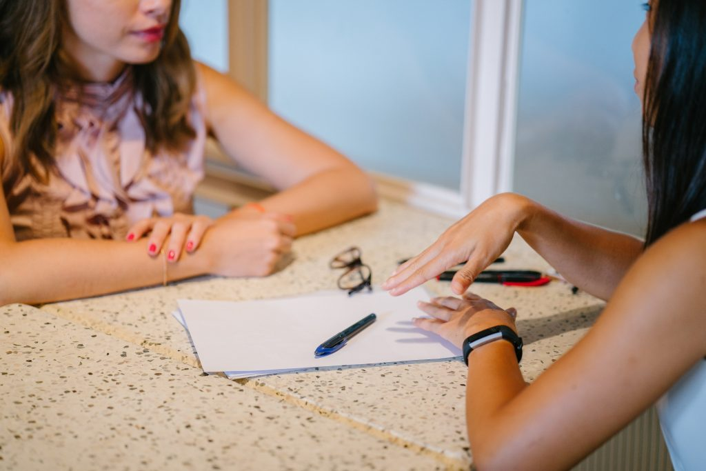 What is rental verification? 2 female in a meeting