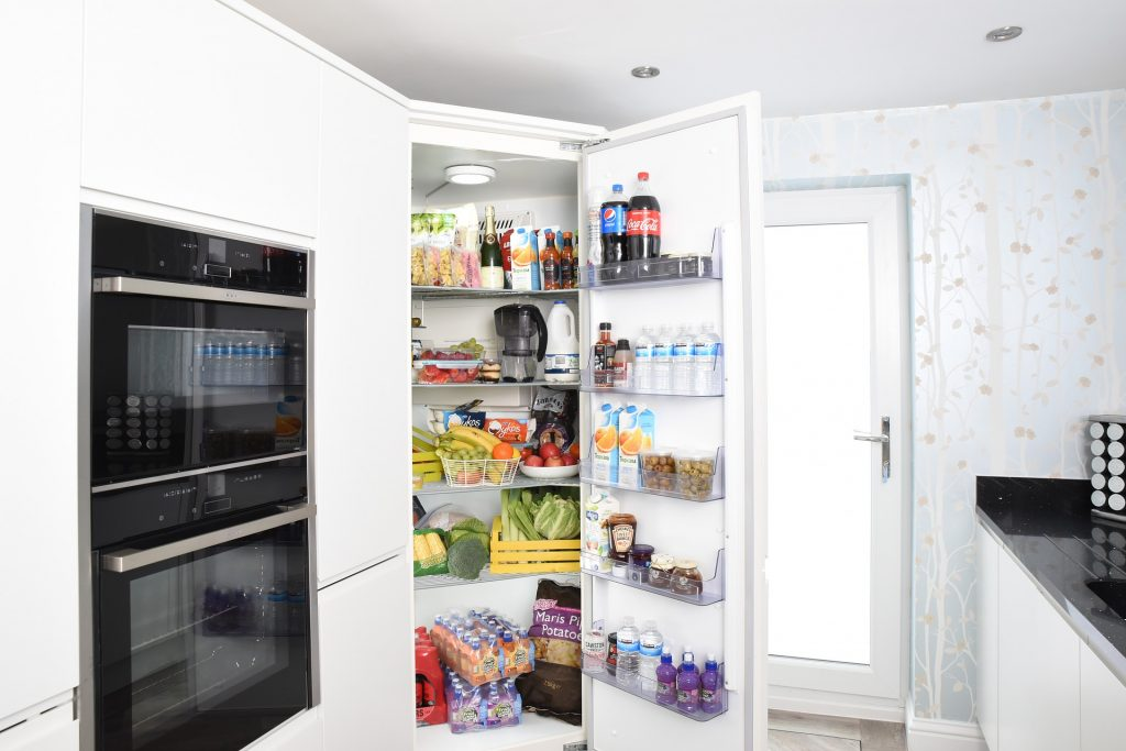 A picture of n open refrigerator for the article when should you replace your refrigerator