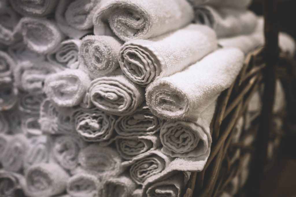 what to do with old towels? Re-purpose them! a picture of a basket full of towels